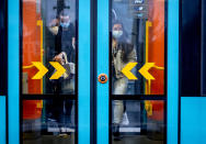 Passengers wear face mask mask as they enter a subway in Frankfurt, Germany, Wednesday, Oct. 28, 2020. (AP Photo/Michael Probst)