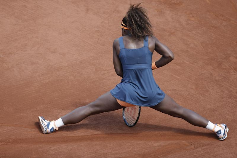 Serena Williams of the U.S. leans on her racket in her match against Italy's Roberta Vinci in their fourth round match at the French Open tennis tournament, at Roland Garros stadium in Paris, Sunday June 2, 2013. (AP Photo/Christophe Ena)