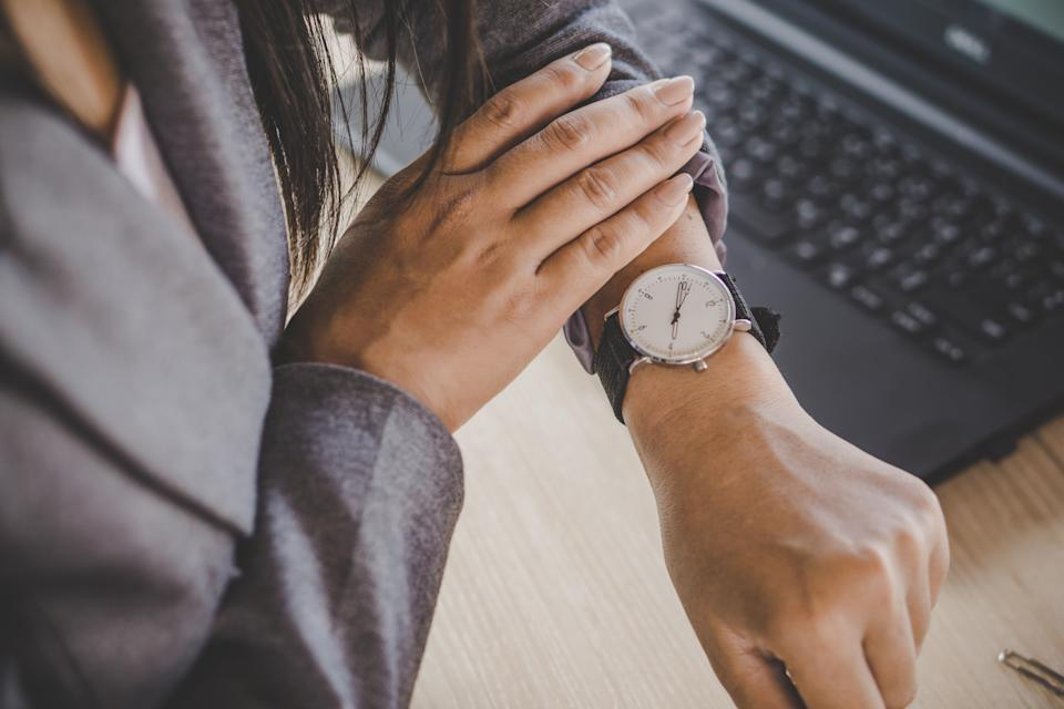 Man looks at watch, running late because of sex
