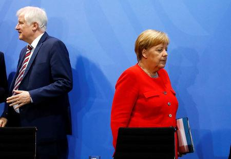 German Chancellor Angela Merkel and Interior Minister Horst Seehofer leave a news conference following the so called a housing summit on rising rents in many German cities and a general shortage of affordable housing in Berlin