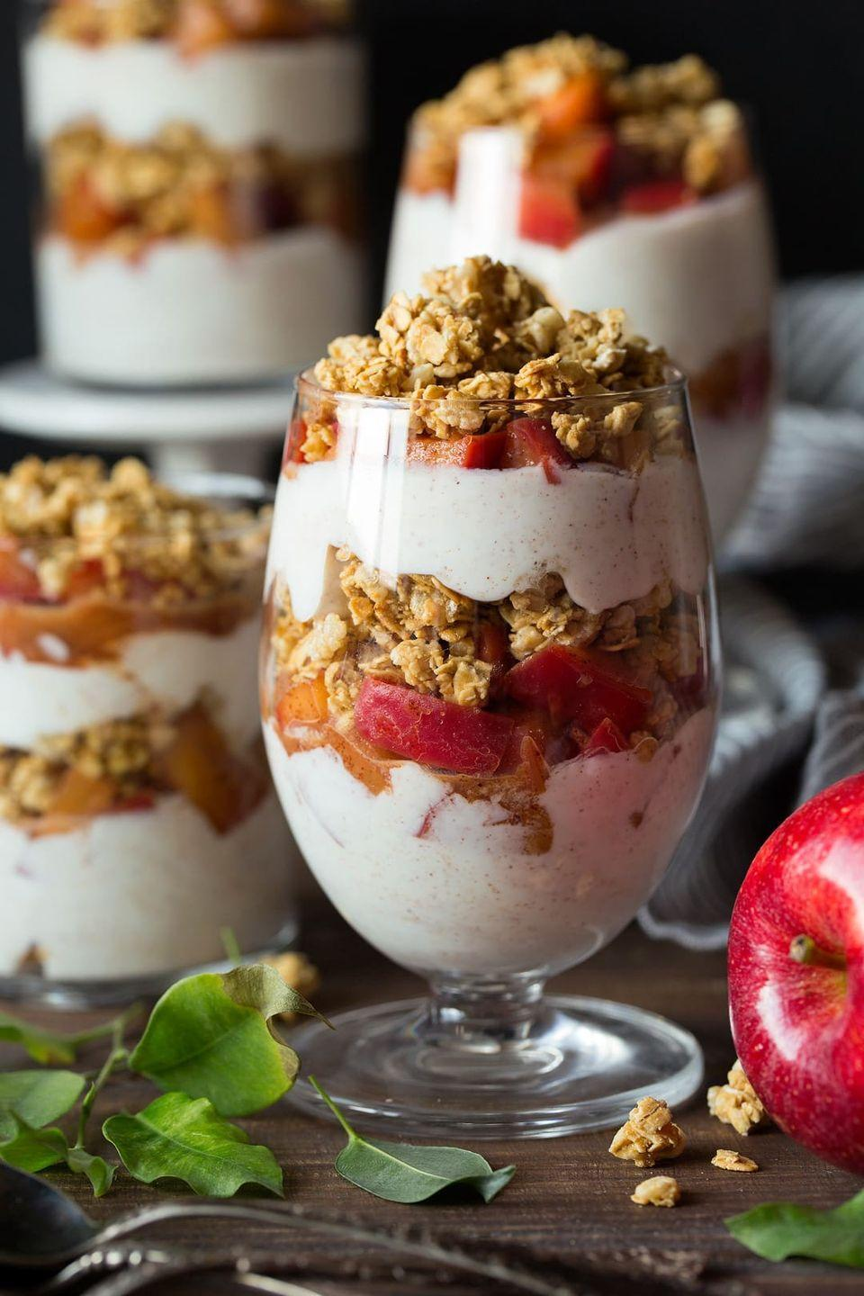 """<p>If you're a fan of apple crumble, you'll love this parfait recipe. Layers of Greek yogurt, softened spiced apples, and crunchy granola make this healthy breakfast a real treat.</p><p><strong>Get the recipe at <a href=""""https://www.cookingclassy.com/apple-cinnamon-granola-parfaits/"""" rel=""""nofollow noopener"""" target=""""_blank"""" data-ylk=""""slk:Cooking Classy"""" class=""""link rapid-noclick-resp"""">Cooking Classy</a>.</strong></p><p><strong><a class=""""link rapid-noclick-resp"""" href=""""https://go.redirectingat.com?id=74968X1596630&url=https%3A%2F%2Fwww.walmart.com%2Fsearch%2F%3Fquery%3Dpioneer%2Bwoman%2Bmeasuring%2Bcup&sref=https%3A%2F%2Fwww.thepioneerwoman.com%2Ffood-cooking%2Fmeals-menus%2Fg34922086%2Fhealthy-breakfast-ideas%2F"""" rel=""""nofollow noopener"""" target=""""_blank"""" data-ylk=""""slk:SHOP MEASURING CUPS"""">SHOP MEASURING CUPS</a><br></strong></p>"""