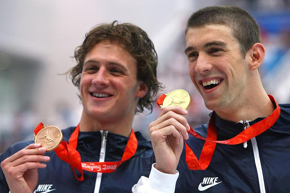 <p>Gold medalist Michael Phelps and bronze medalist Ryan Lochte (L) pose during the medal ceremony for the 200m individual medley final on August 15, 2008 in Beijing, China. Phelps won in a new world record time of 1.54.23. (Lars Baron/Bongarts/Getty Images)</p>