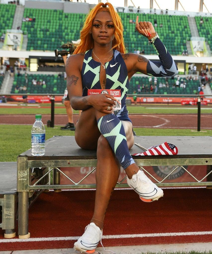EUGENE, OREGON – JUNE 19: Sha'Carri Richardson raises her fist after winning the Women's 100 Meter final on day 2 of the 2020 U.S. Olympic Track & Field Team Trials at Hayward Field on June 19, 2021 in Eugene, Oregon. (Photo by Patrick Smith/Getty Images)