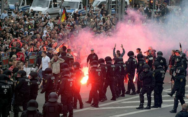 PHOTO: In this Aug 27, 2018, file photo, protesters light fireworks during a far-right demonstration in Chemnitz, Germany. (Jens Meyer/AP, File)
