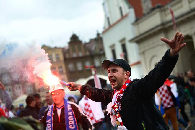 TOPSHOTS A Croatian fan lights a torch at the central square in Poznan on June 14, 2012, before their Euro 2012 football championships match against Italy.       AFP PHOTO / DIMITAR DILKOFFDIMITAR DILKOFF/AFP/GettyImages