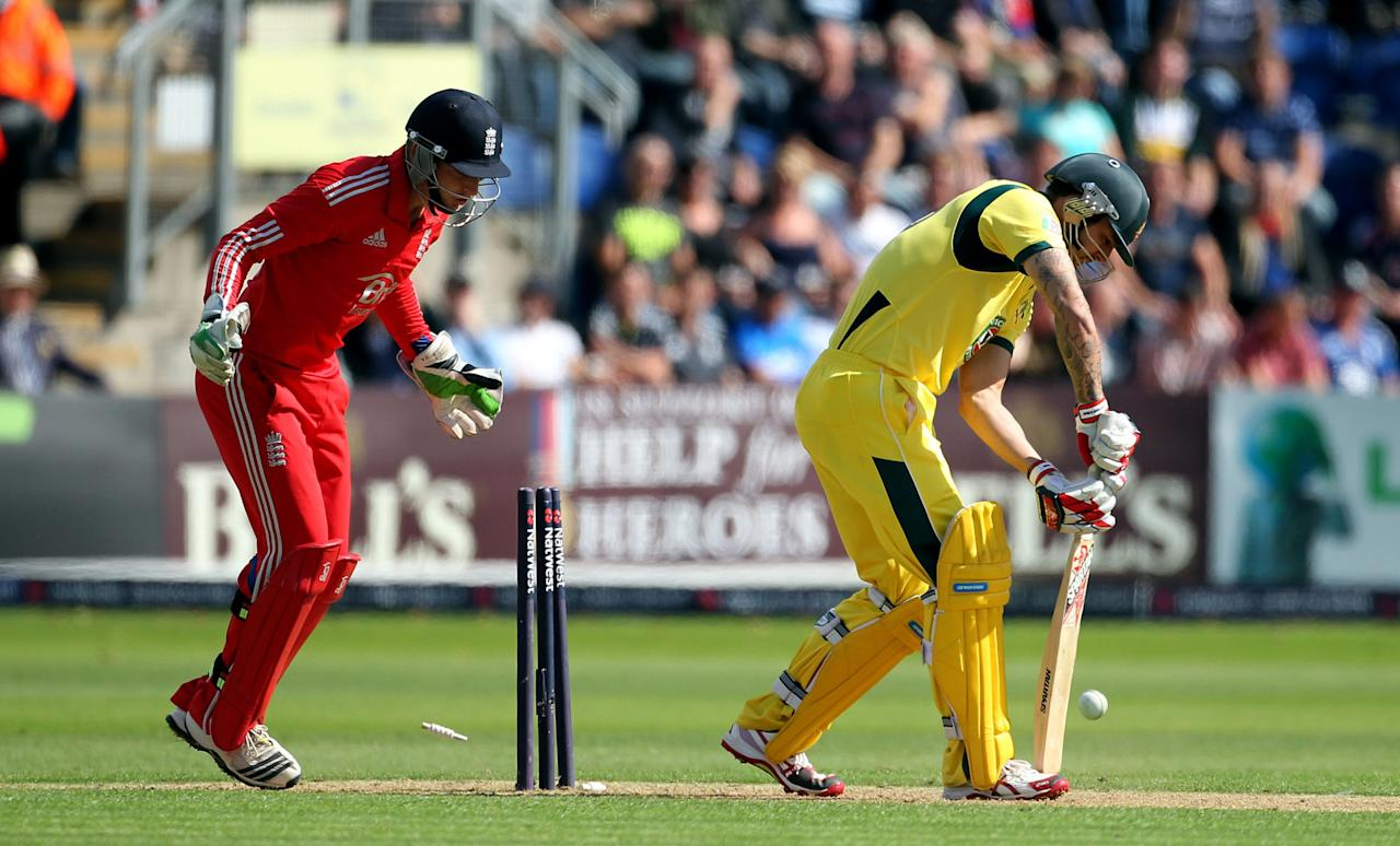 Australia's Mitchell Johnson is bowled by England's James Tredwell during the fourth one day international at the SWALEC Stadium, Cardiff.