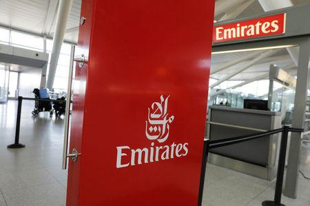 An Emirates Airlines ticket desk stands empty at JFK International Airport in New York