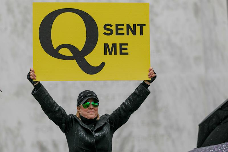 A QAnon conspiracy theorist demonstrates at an anti-quarantine protest in Salem, Oregon, on May 2. (John Rudoff/Anadolu Agency via Getty Images)