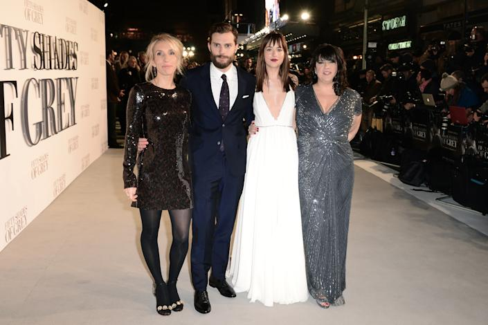 Sam Taylor-Johnson, Jamie Dornan, Dakota Johnson and E L James attending the UK premiere of Fifty Shades of Grey at the Odeon Leicester Square, London. PRESS ASSOCIATION Photo. Picture date: Thursday February 12, 2015. See PA story SHOWBIZ Fifty. Photo credit should read: Dominic Lipinski/PA Wire
