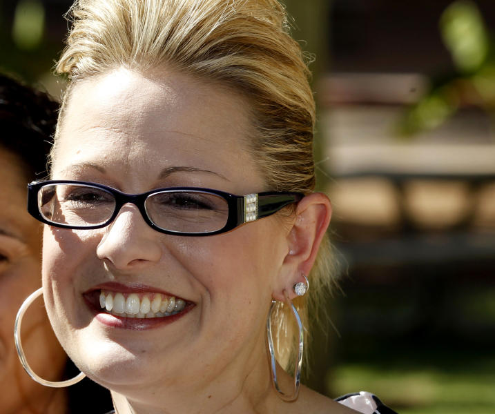 """FILE - In this June 28, 2012 file photo, Arizona Democratic Rep. candidate, Arizona State Sen. Kyrsten Sinema, is seen at the Arizona Capitol in Phoenix. Of the four openly gay members of Congress, the two longest-serving stalwarts are vacating their seats. Instead of fretting, their activist admirers are excited about a record crop of gays vying to win seats in the next Congress _ and to make history in the process. A common denominator in all the races: neither the gay candidates nor their rivals are stressing sexual orientation, and the oft-heard refrain is, """"It's not an issue."""" If anti-gay innuendo does surface from lower echelons of a campaign, there are swift disavowals _ even conservative candidates these days think twice about being depicted as biased against gays and lesbians. (AP Photo/Ross D. Franklin, File)"""