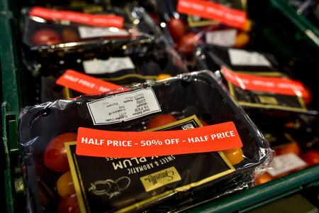FILE PHOTO: Discount stickers are attached to packs of tomatoes in an Aldi store in London, Britain February 15, 2018. REUTERS/Peter Summers/File Photo
