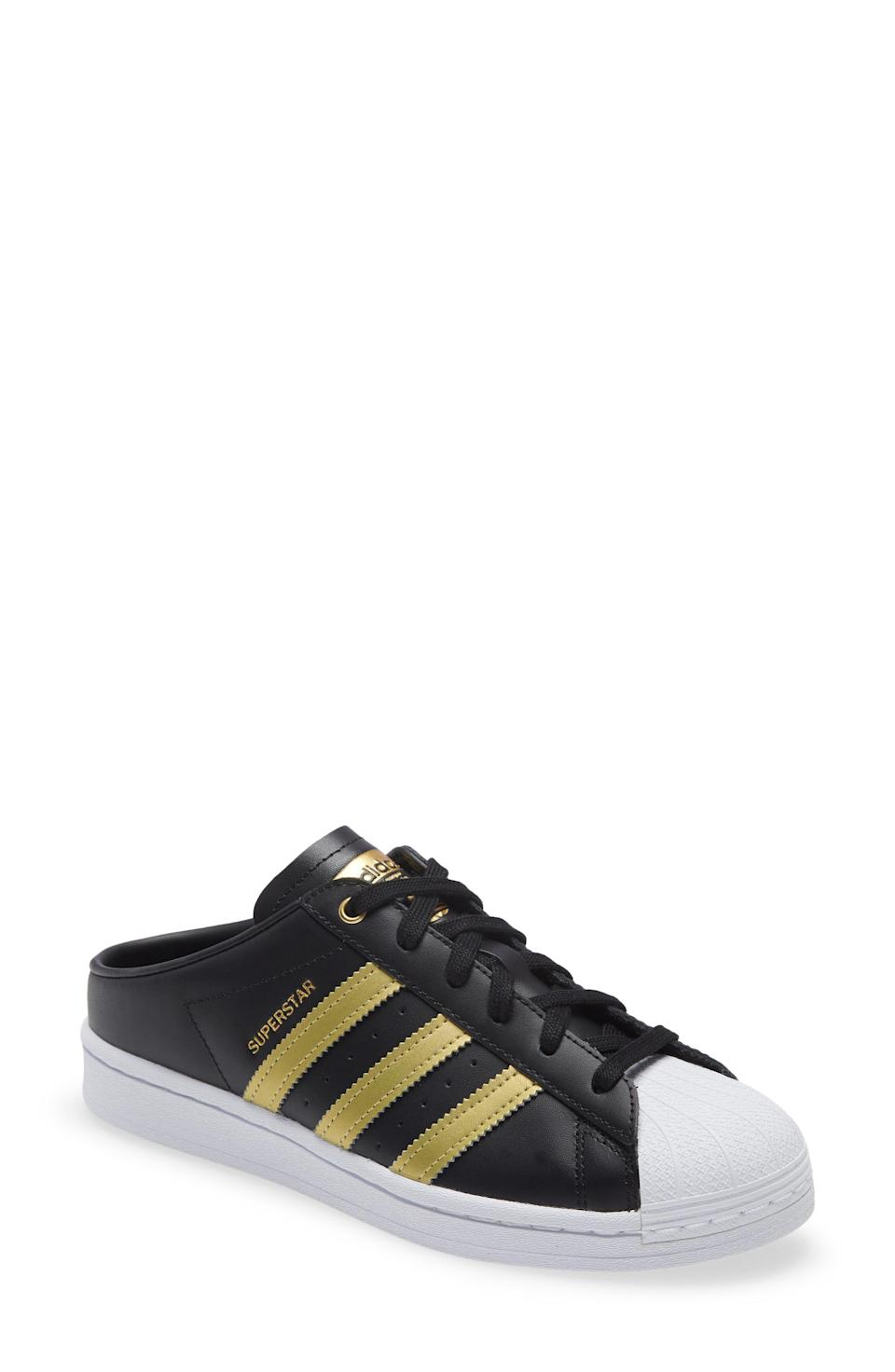"""<p><strong>ADIDAS</strong></p><p>nordstrom.com</p><p><strong>$85.00</strong></p><p><a href=""""https://go.redirectingat.com?id=74968X1596630&url=https%3A%2F%2Fwww.nordstrom.com%2Fs%2Fadidas-superstar-mule-sneaker-women%2F5654167&sref=https%3A%2F%2Fwww.womenshealthmag.com%2Ffitness%2Fg36063460%2Fbest-black-sneakers%2F"""" rel=""""nofollow noopener"""" target=""""_blank"""" data-ylk=""""slk:Shop Now"""" class=""""link rapid-noclick-resp"""">Shop Now</a></p><p>There's nothing like a good slip-on sneaker. For the days I'm too lazy to bend down and tie my laces (which is most of the time), slip-ons like these are an essential. </p><p>Plus, the gold accent makes these super stylish—a go-to for fun summer picnics when you want to take your shoes on and off.</p>"""