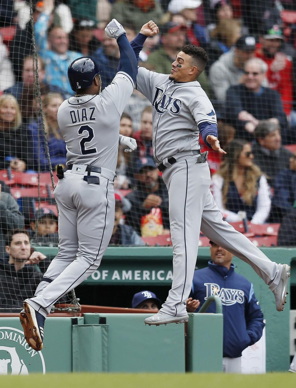 Tampa Bay Rays' Yandy Diaz (2) celebrates his solo home run with teammate Willy Adames during the first inning of a baseball game against the Boston Red Sox in Boston, Saturday, April 27, 2019. (AP Photo/Michael Dwyer)