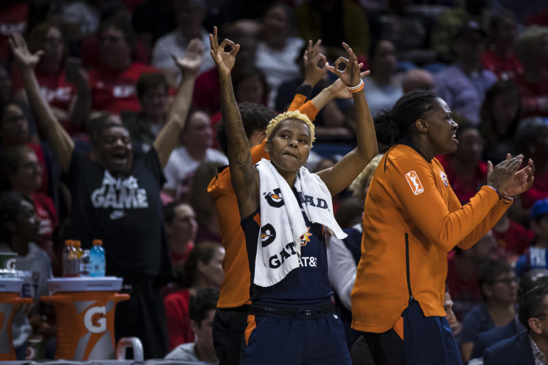 WASHINGTON, DC - OCTOBER 01: Courtney Williams #10 of the Connecticut Sun celebrates with teammates against the Washington Mystics during the first half of Game Two of the 2019 WNBA finals at St Elizabeths East Entertainment & Sports Arena on October 1, 2019 in Washington, DC. NOTE TO USER: User expressly acknowledges and agrees that, by downloading and or using this photograph, User is consenting to the terms and conditions of the Getty Images License Agreement. (Photo by Scott Taetsch/Getty Images)