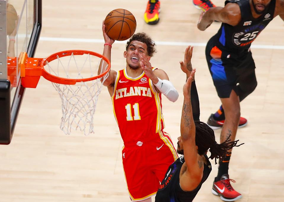 Trae Young (11) has averaged 27.5 points in leading the Hawks to a 3-1 series over the Knicks in his playoff debut.