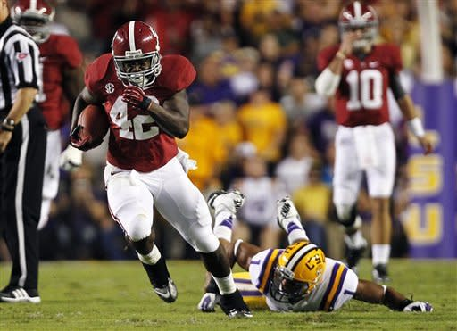 Alabama running back Eddie Lacy (42) carries past LSU safety Eric Reid (1) in the first half of their NCAA college football game in Baton Rouge, La., Saturday, Nov. 3, 2012. (AP Photo/Gerald Herbert)