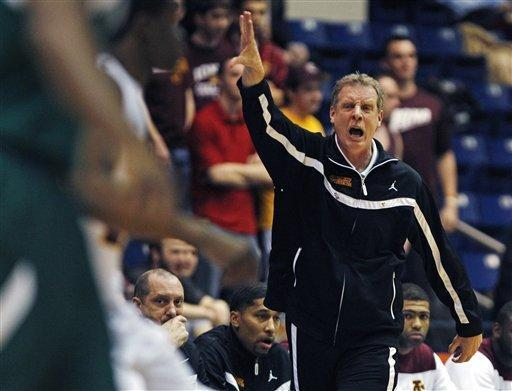 Iona head coach Tim Cluess calls to his players during the first half of the 2013 MAAC Championship NCAA college basketball game against Manhattan in Springfield, Mass., Monday, March 11, 2013. (AP Photo/Charles Krupa)