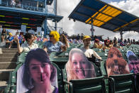 Fans wait for the competition at the Nathan's Famous Fourth of July International Hot Dog-Eating Contest in Coney Island's Maimonides Park on Sunday, July 4, 2021, in New York. (AP Photo/Brittainy Newman)
