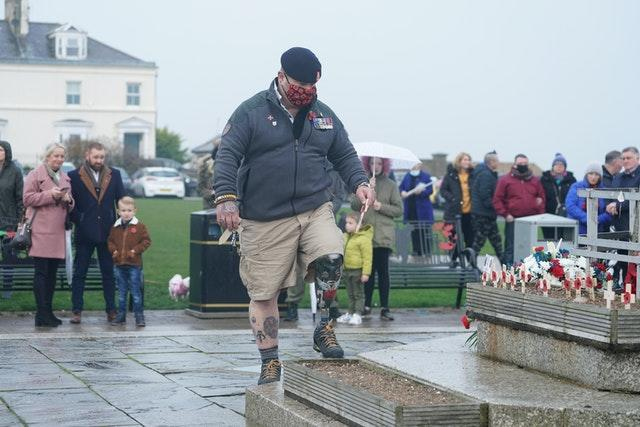 A veteran places a cross during the Seaham ceremony
