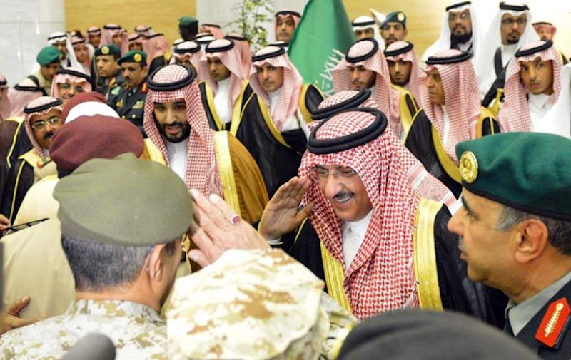 Handout picture by the Saudi Press Agency on April 29, 2015 at a royal palace in Riyadh shows Saudi well-wishers greeting the new appointed Crown Prince Mohammed bin Nayef bin Abduaziz (C-R) and new Deputy Crown Prince Mohammed bin Salman