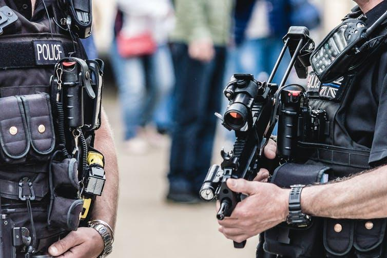 Guns in the hands of armed police.