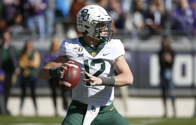 Baylor quarterback Charlie Brewer (12) looks to throw against TCU during the first half of an NCAA college football game, Saturday, Nov. 9, 2019, in Fort Worth, Texas. (AP Photo/Ron Jenkins)