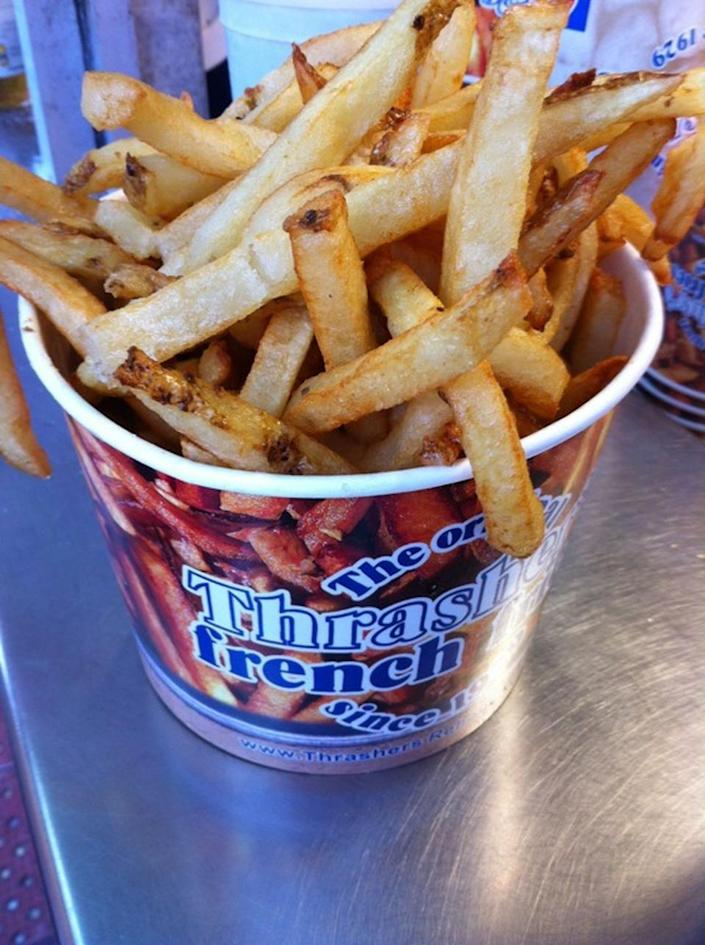 """<p><a href=""""https://www.yelp.com/biz/thrashers-french-fries-bethany-beach"""" rel=""""nofollow noopener"""" target=""""_blank"""" data-ylk=""""slk:Thrasher's French Fries"""" class=""""link rapid-noclick-resp"""">Thrasher's French Fries</a>, Rehoboth Beach</p><p>""""Woah. What did I just eat? Eat this. I don't know what they do to the fries, but it's good."""" -Foursquare user <a href=""""https://foursquare.com/foamingbbq"""" rel=""""nofollow noopener"""" target=""""_blank"""" data-ylk=""""slk:Angie Harmon"""" class=""""link rapid-noclick-resp"""">Angie Harmon</a></p>"""