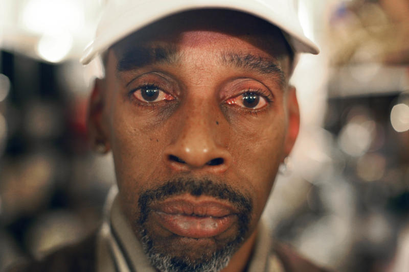 "In this Thursday, Sept. 15, 2011 photo, Mark Blakey, a resident of the REST Shelter in Chicago and a former drug addict, poses for a portrait at the shelter. Blakey, 54, lost his job because of a cocaine addiction and spends his time going to recovery meetings, spending time with an aunt or just walking around the city.  ""I keep myself busy,"" he said.  ""I feel blessed I have somewhere to go."" (AP Photo/Charles Rex Arbogast)"