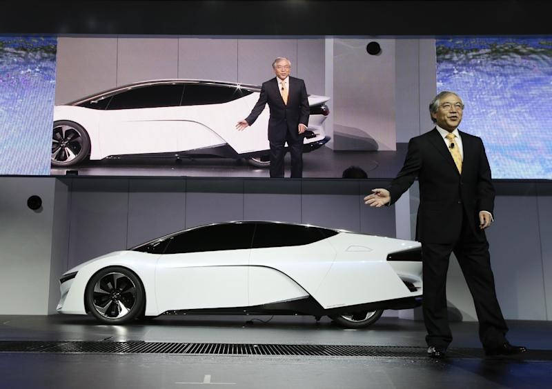 Tetsuo Iwamura, president and chief executive officer of American Honda Motor Co., Inc., talks about the Honda FCEV Concept during it's debut at the Los Angeles Auto Show in Los Angeles, Wednesday, Nov. 20, 2013. (AP Photo/Chris Carlson)