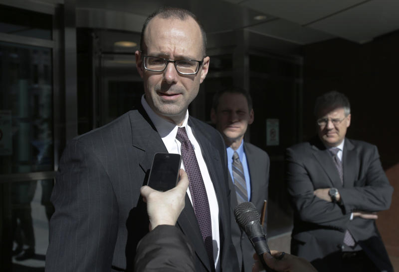 Prosecutor Andrew Winter talks to reporters after a federal jury Tuesday, March 19, 2013, in Minneapolis convicted three alleged members of an American Indian gang accused of terrorizing people in the Upper Midwest. (AP Photo/Jim Mone)