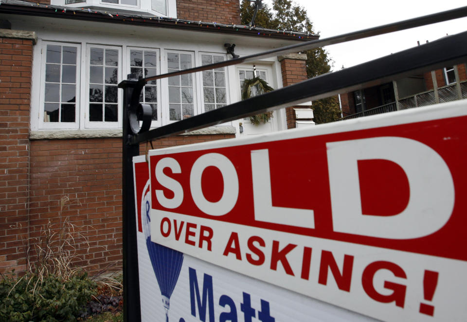 A sold sign is displayed in front of a home in Toronto (Reuters)