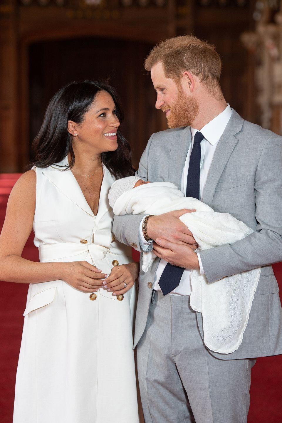 <p>Harry and Meghan pose with their newborn son, Archie Harrison Mountbatten-Windsor, during a photocall in St. George's Hall at Windsor Castle.</p>
