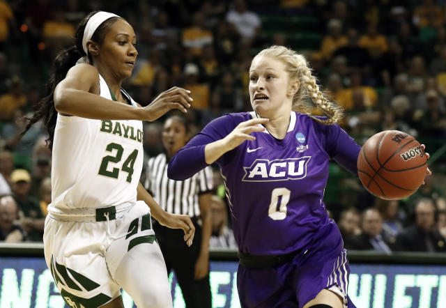 Baylor guard Chloe Jackson (24) defends against a drive to the basket by Abilene Christian 's Kamryn Mraz (0) in a first-round game in the NCAA womens college basketball tournament in Waco, Texas, Saturday March 23, 2019.(AP Photo/Tony Gutierrez)