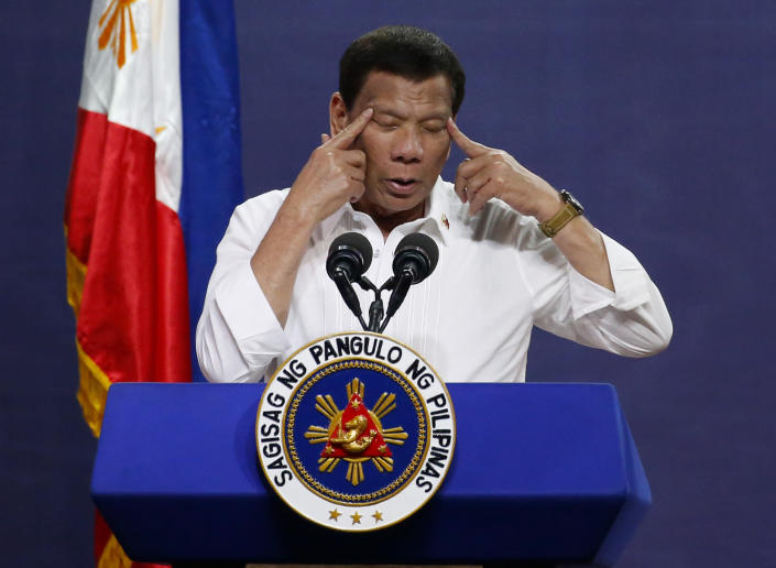 """FILE - In this Tuesday Aug. 27, 2019 file photo Philippine President Rodrigo Duterte gestures as he addresses land reform beneficiaries on the 31st year of the implementation of the Comprehensive Agrarian Reform Program (CARP) in suburban Quezon city northeast of Manila, Philippines. International Criminal Court judges on Wednesday Sept. 15, 2021, authorized an investigation into the Philippines' deadly """"war on drugs"""" campaign, saying the crackdown """"cannot be seen as a legitimate law enforcement operation."""" (AP Photo/Bullit Marquez, File)"""