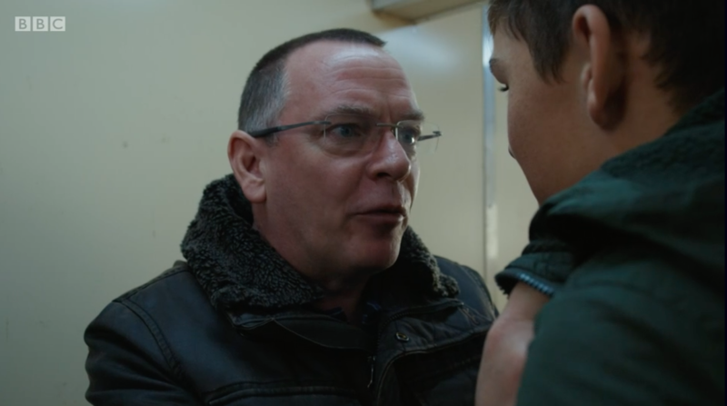 Ian Beale locks Dennis Mitchell in a room on the boat during EastEnders 35th anniversary. (BBC/iPlayer)