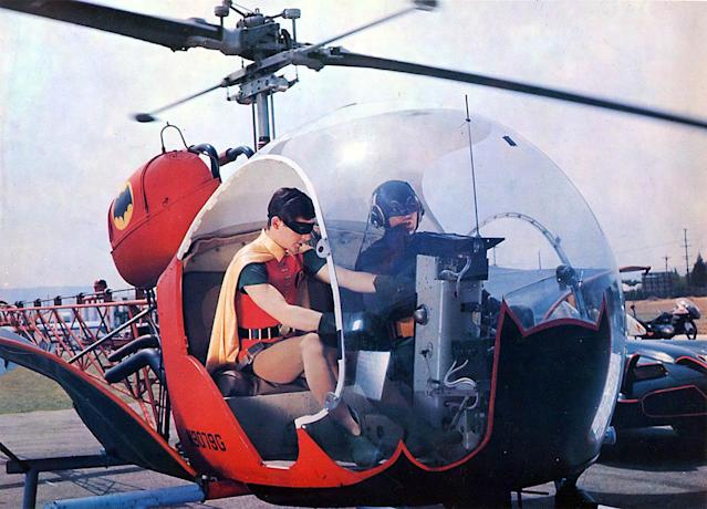 Robin (Burt Ward) and Batman (Adam West) at the controls of the classic Batcopter in <em> Batman</em>. (Photo: 20th Century Fox TV)