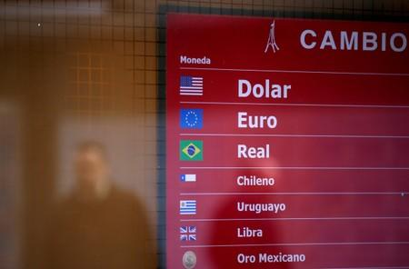 FILE PHOTO: An electronic board is seen at a currency exchange shop, in Buenos Aires