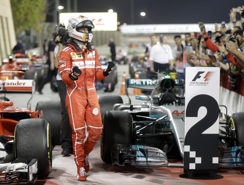 Ferrari driver Sebastian Vettel of Germany celebrates after winning the Bahrain Formula One Grand Prix, at the Formula One Bahrain International Circuit in Sakhir, Bahrain, Sunday, April 16, 2017. (AP Photo/Luca Bruno)