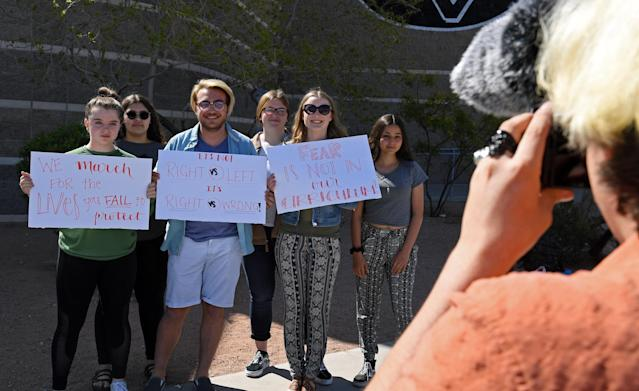 <p>Palo Verde High School students (L-R) Mallory McKissick, Raven Green, Eli Duncan, Nicole Sandberg, Ainslee Archibald and Sonia Agrebi pose outside the school while fellow student Jake Grosvenor takes photos as they participate in the National School Walkout on the 19th anniversary of the 1999 mass shooting that killed 13 people at Columbine High School on April 20, 2018 in Las Vegas, Nev. (Photo: Ethan Miller/Getty Images) </p>