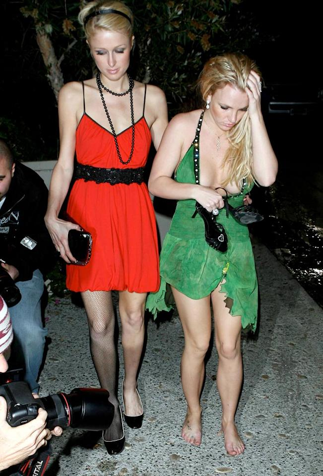 "After a long night of partying Britney ditches the shoes, yet Paris still has on her one-legged fishnets. Bad choice, Paris. Lins-AlphaX-Castro/<a href=""http://www.x17online.com"" target=""new"">X17 Online</a> - November 26, 2006"