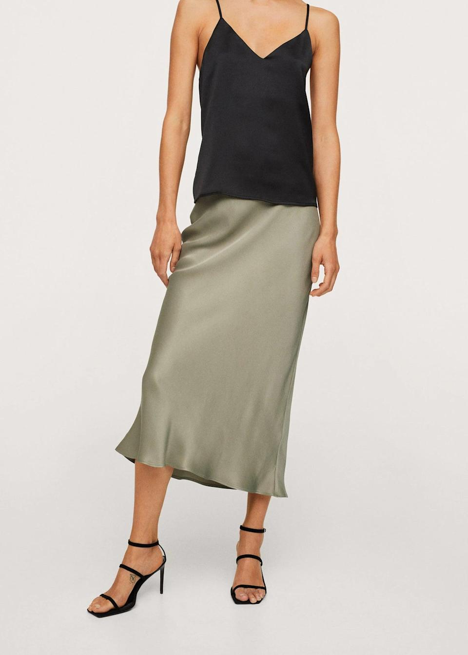<p>This <span>Midi Satin Skirt</span> ($80) can easily be styled for daytime wear (just throw on a sweater and sneakers) or for nighttime (with the help of a fitted tank top and some mules). We like the versatility of it.</p>