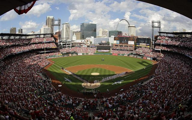 The St. Louis Cardinals and the Pittsburgh Pirates are introduced before the start of Game 1 of baseball's National League division series on Thursday, Oct. 3, 2013, in St. Louis. (AP Photo/Mark Humphrey)