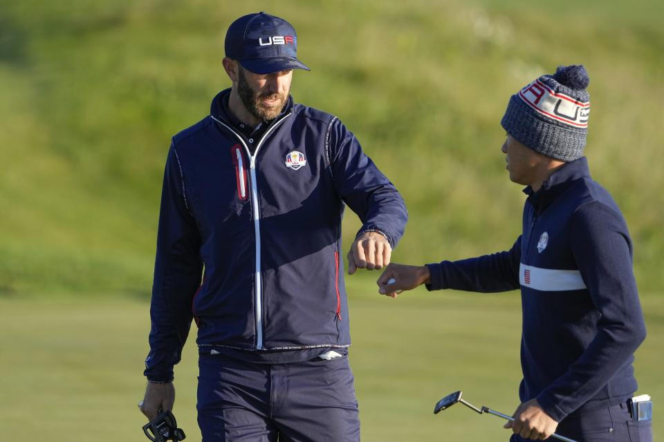 Team USA's Dustin Johnson and Team USA's Collin Morikawa react on the second hole during a foursomes match the Ryder Cup at the Whistling Straits Golf Course Saturday, Sept. 25, 2021, in Sheboygan, Wis. (AP Photo/Jeff Roberson)