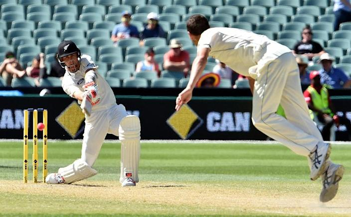 New Zealand batsman Trent Boult (L) is clean bowled off Australia paceman Jash Hazlewood during the third day of the day-night Test at the Adelaide Oval on November 29, 2015 (AFP Photo/Saeed Khan)
