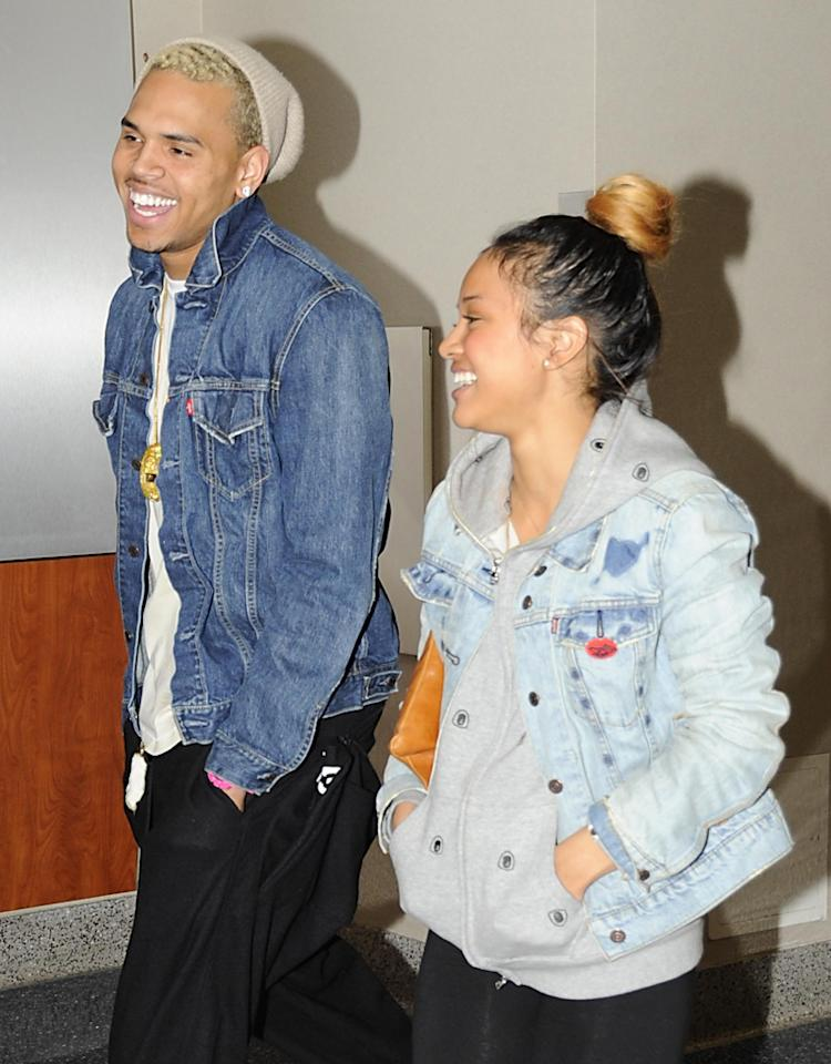Chris Brown and his girlfriend Karrueche Tran are seen sharing laughs as they catch a really early morning flight out of Richmond International Airport. 