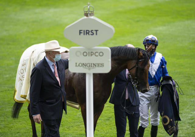 Trainer John Gosden and jockey James Doyle in the winners enclosure after Lord North's victory in the Prince Of Wales's Stakes at Royal Ascot