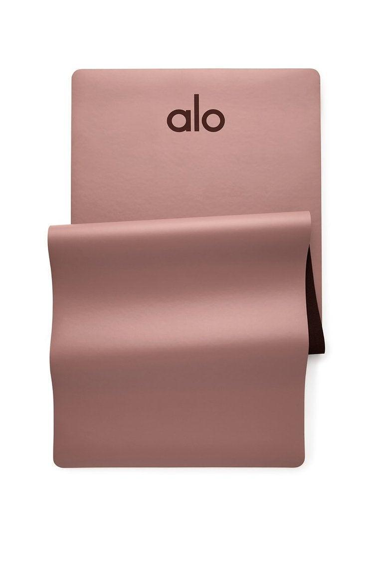 "<h3>Alo Yoga Warrior Mat <br></h3><br>""I have used many, many yoga mats in my day, and this one is my favorite. It's heavy (so it doesn't slide around while I'm working out), it's cushioned (to protect my arms during up-downs), it's easy to clean, and while it's expensive, it's super-durable. The one I have is just solid black, with a discreet logo — chic, even if I'm just using it at home."" — <em>MZ</em><br><br><strong>Alo Yoga</strong> Warrior Mat, $, available at <a href=""https://go.skimresources.com/?id=30283X879131&url=https%3A%2F%2Fwww.aloyoga.com%2Fproducts%2Fw7092r-warrior-mat-smoky-quartz"" rel=""nofollow noopener"" target=""_blank"" data-ylk=""slk:Alo Yoga"" class=""link rapid-noclick-resp"">Alo Yoga</a>"