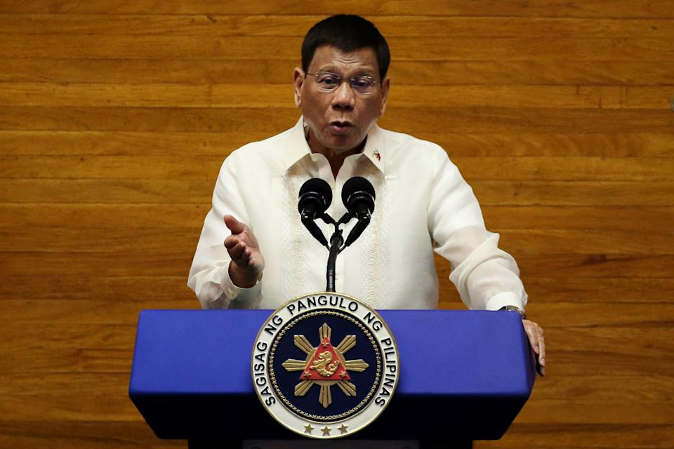 Philippine President Rodrigo Duterte gestures as he delivers his 6th State of the Nation Address (SONA), at the House of Representative in Quezon City, Metro Manila, Philippines, July 26, 2021. REUTERS/Lisa Marie David