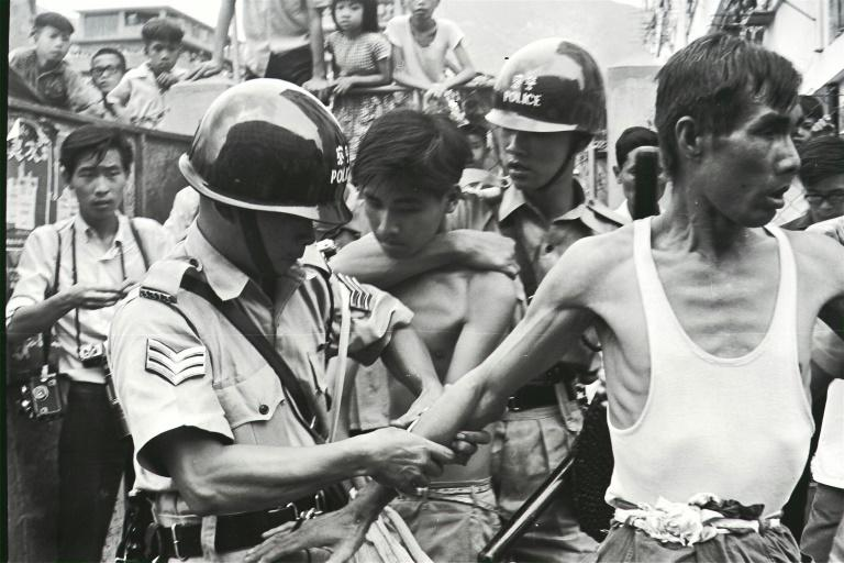 In this South China Morning Post (SCMP) archive photo taken on May 12, 1967, police arrest two left-wing demonstrators during a clash in San Po Kong, in Hong Kong