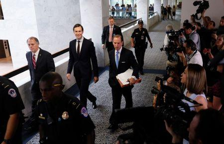 White House Senior Adviser Jared Kushner (C) and his attorney Abe Lowell (R) depart following Kushner's appearance before a closed session of the Senate Intelligence Committee as part of their probe into Russian meddling in the 2016 U.S. presidential election, on Capitol Hill in Washington, U.S. July 24, 2017. REUTERS/Jonathan Ernst